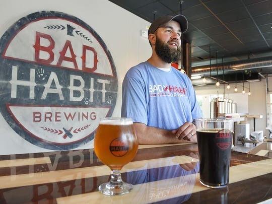 Aaron Rieland, founder of Bad Habit Brewing Co., in his taproom.