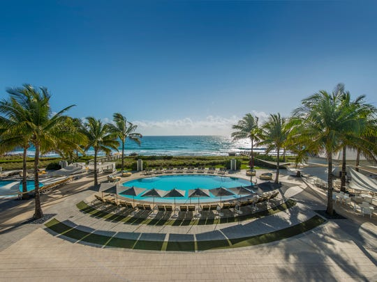 Guests visiting the Boca Raton Resort & Club, A Waldorf Astoria Resort bask in oceanfront views poolside coupled with a half mile of private beach along the Atlantic coast at the Boca Beach Club section of the property.