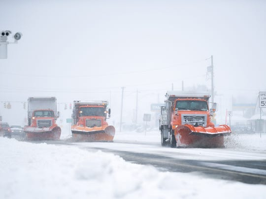 A convoy of snow plows heads south on US 13 in Dover near the Scarborough Road intersection.