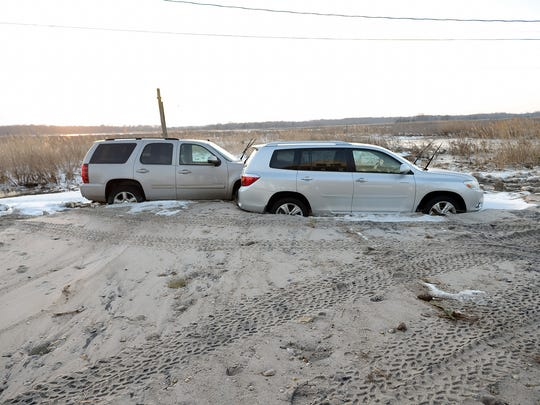 Tom Antonio, a year-round Pickering Beach resident, says two of his cars were pushed together and up onto his property after Saturday's storm.