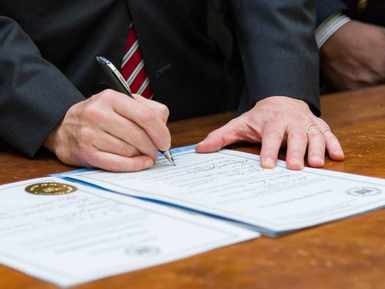 Gov. Jack Markell signing House Joint Resolution 10,