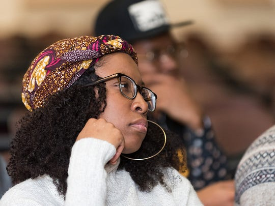 Kayla Edward-Stewart, a sophomore at Delaware State University, listens to the Democratic presidential debate broadcast Thursday. The youth vote is a key component of both campaigns by U.S. Sen. Bernie Sanders and Hillary Clinton.