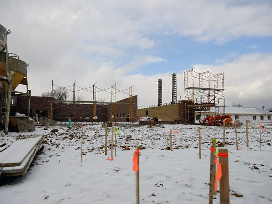 The brick frame of the new Goodwill store is being built as work progresses, as well, on the building behind it Friday, Feb. 12 in Portland as the city continues to recover from an EF-1 tornado that struck in late June.