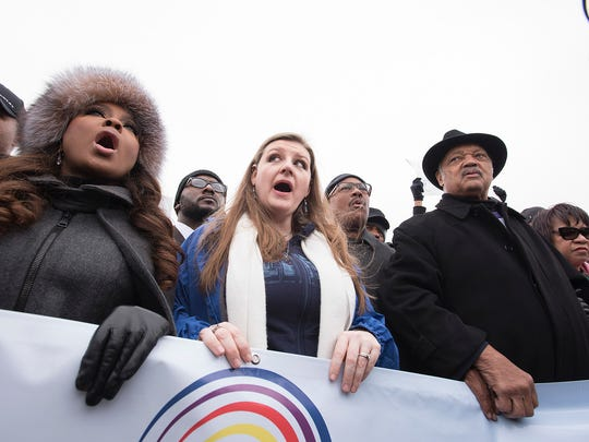 Flint resident and community activist Melissa Mays, center, the Rev. Jesse Jackson and Phaedra Parks during the march.