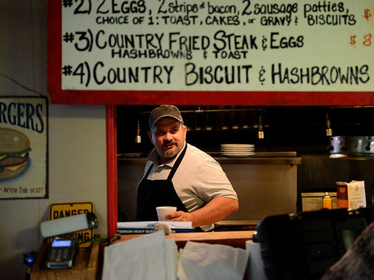 """Rob Piercefield speaks with customers through a window from the kitchen at his diner, Swede's, Friday, Feb. 19, 2016, right off M-43 in Mulliken. Piercefield, who is also the Mullliken village president, said he knew Guilford. """"I never had a bit of trouble with him,"""" he said."""