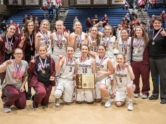 Southern Fulton girls basketball team pose together with their medals and plaque after winning the District 5 girls basketball championshipin Johnstown, Pa on Saturday, Feb. 27, 2016. Southern Fulton defeated McConnellsburg 50-41.