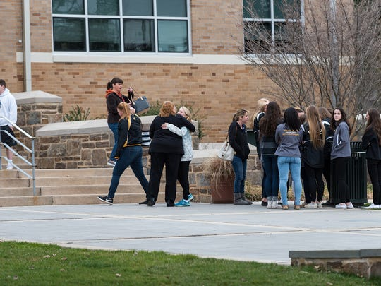 Visitors gather at Salesianum School in Wilmington on Saturday, where a service was held for Tyler Brown, a 17-year-old student killed in a crash late Friday in southern New Castle County. Four others were injured.