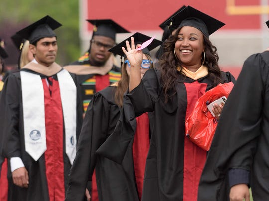 Delaware State University students graduate during a ceremony on May 17. The Dover school is re-configuring academic programs.