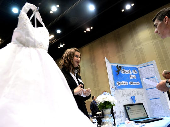 """Jenna Cody, 18, from St. Johns High School, pitches her business, """"Struck by Eros Wedding Planning"""" to a judge during the Youth Startup Challenge at the Lansing Center, where nearly 200 students from the tri-county area competed for $20,000."""
