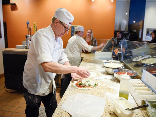Frank Galli owner of Pompeii Pizzeria works on lunch