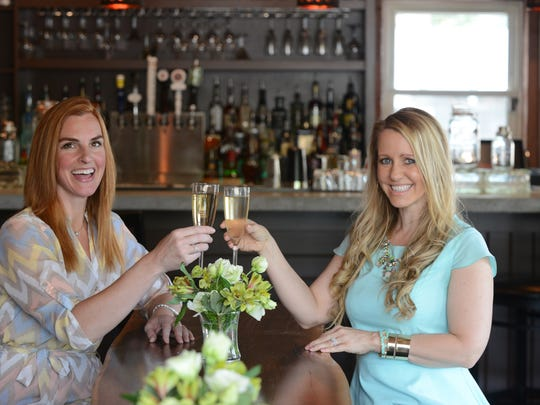 Heather Frechette, left, and Elizabeth Hunt, right, will be opening The 05, a bar named for the neighborhood and zip code along Augusta Road.