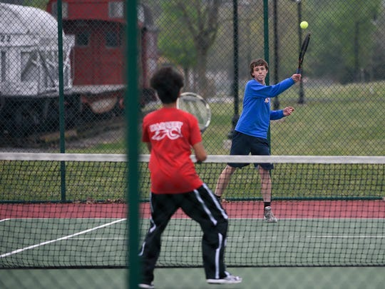 Chambersburg's Aaron Muldowney returns a serve to Fabian Berrun of Central Dauphin East during a tennis match on Wednesday, April 27, 2016 at Norlo Park in Fayetteville, Pa. Muldowney and Berrun were playing against each other in No. 1 doubles.