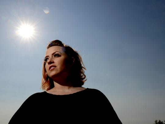 """Jeannie Kennedy, a former prostitute, is pictured Friday, May 6, 2016, in St. Johns. Kennedy now works to help victims escape with the Human Trafficking Task Force in Shiawassee County and others. A born-again Christian, Kennedy said she's thankful for where her life is now. """"For me it's important for the girls coming out [of prostitution] to be revamped inside and out. When you're in it, you think that's all you're valuable for. And that's not it. It's not."""""""
