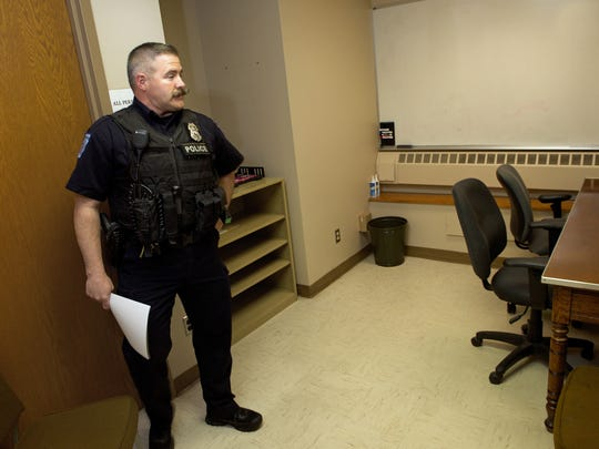 Officer Mark Taylor enters the interview room Wednesday, May 11, 2016 at Waynesboro Police Department. Each local department has similar ways to recording interviews to be used as evidence.