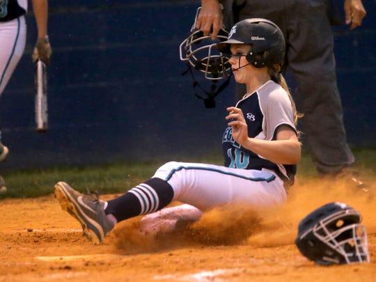 Siegel's Caitlyn McCrary slides into home, scoring