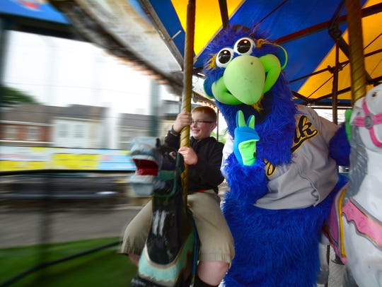 York Revolution mascot Downtown gets a carousel ride