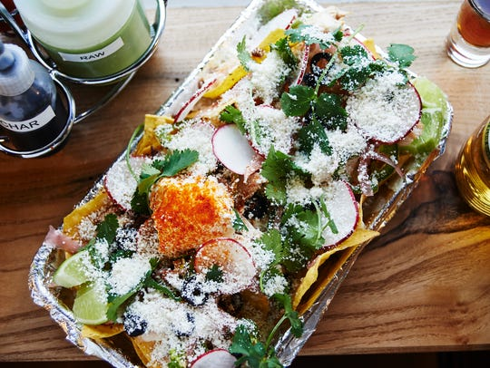 Enjoy nachos with or without meat at Bastion.
