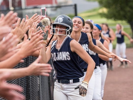 The Lady Trojans run down the field and high five their fans after winning the District 3 Class AAAA softball championship against Penn Manor on Thursday, June 2, 2016. Chambersburg defeated Penn Manor 1-0