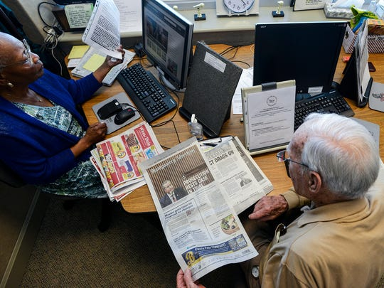 Jim Young reads aloud stories in the Montgomery Advertiser