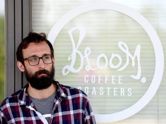 Jared Field, owner of Bloom Roasters, stands outside
