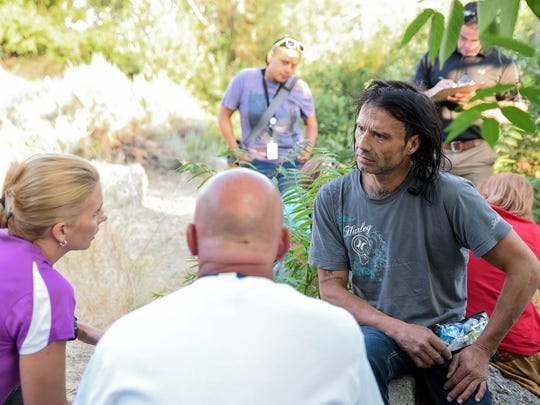 On June 29, 2016, Veterans Affairs service workers talk to Sean Reece about his options for care. He lives with a group of three other people in a series of tents next to the Truckee River. Reece is a veteran of the Navy. He said he is trying to get sober after moving to Reno, abusing drugs and becoming homeless. The VA services can help him with substance abuse, housing and personal care.