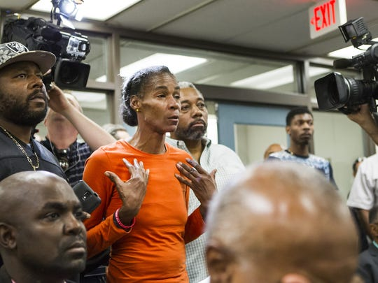 A file photo shows Phyllis McDole speaking at a press conference soon after her son, Jeremy McDole, was fatally shot by Wilmington police in September 2015. Phyllis McDole pleaded guilty Tuesday to third-degree burglary in connection with the assault of a woman who she believed made the 911 call that led to her son's death.