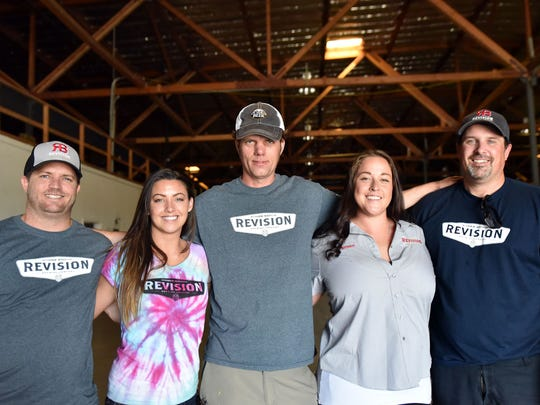 From left, Ken Foster, vice president of distribution and analytics, Darla Roberts, vice president of sales and marketing, Jeb Taylor, presidet and head brewer, Brittani Warren, director of operations and taproom manager, and Jeremy Warren, CEO and co-founder of Revision Brewing pose inside their newly leased 30,000 square foot warehouse. The team will build one of the region's largest breweries by the end of 2016.