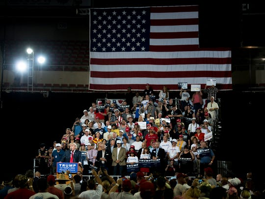 Republican presidential candidate Donald Trump holds a rally in Phoenix. Trump has claimed fraudulent voters will be able to cast multiple ballots without voter ID laws in place.