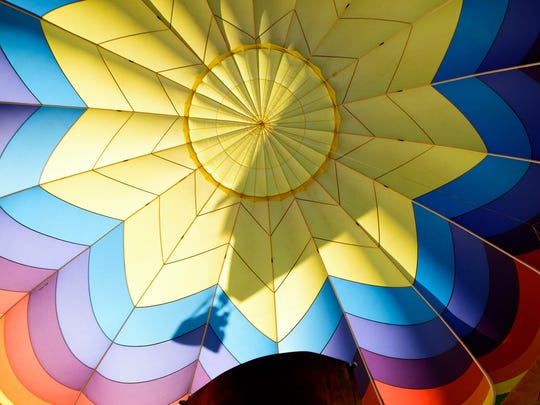 Another balloon rises above Air Chaud 2 and casts a shadow on the interior of the balloon. This photo is shot looking up into the balloon at the Great Reno Balloon Race 2016 media day.