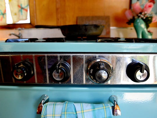 "The vintage stove inside Steve and Deb Viele's 1965 Frolic camper, nicknamed a ""canned ham"" camper, Monday, Sept. 12, 2016 at their home in Dimondale."