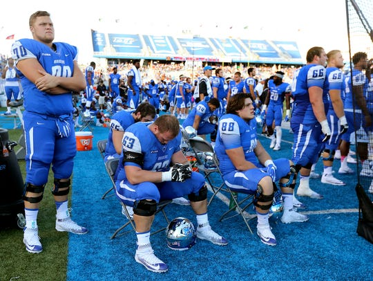MTSU players watch in the second overtime period as WKU has the ball after MTSU missed a field goal try in the first OT period in a game Oct. 15, 2016.