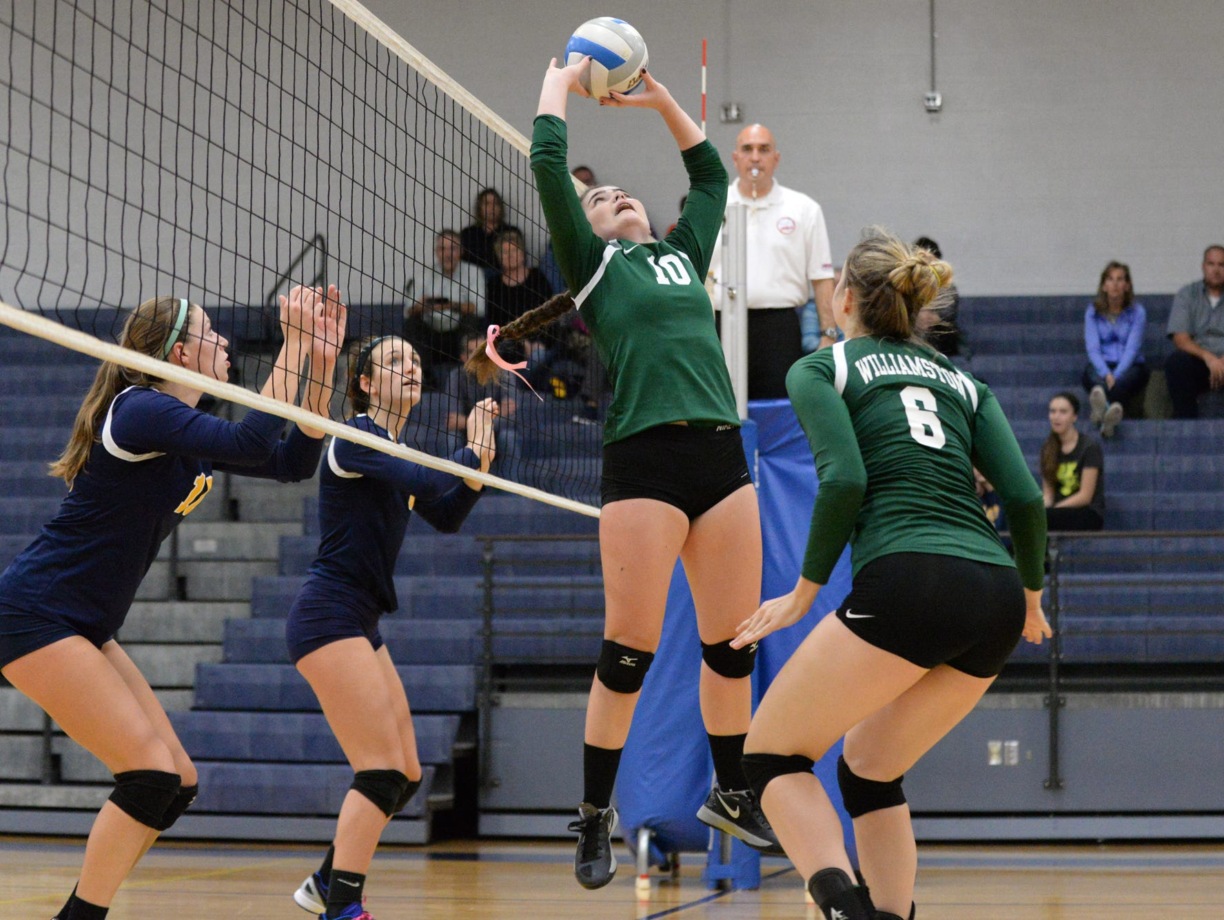 Williamston's Alana Kemler sets the ball on Thursday, Nov. 3, 2016 during the Class B Volleyball District Tournament against Haslett.