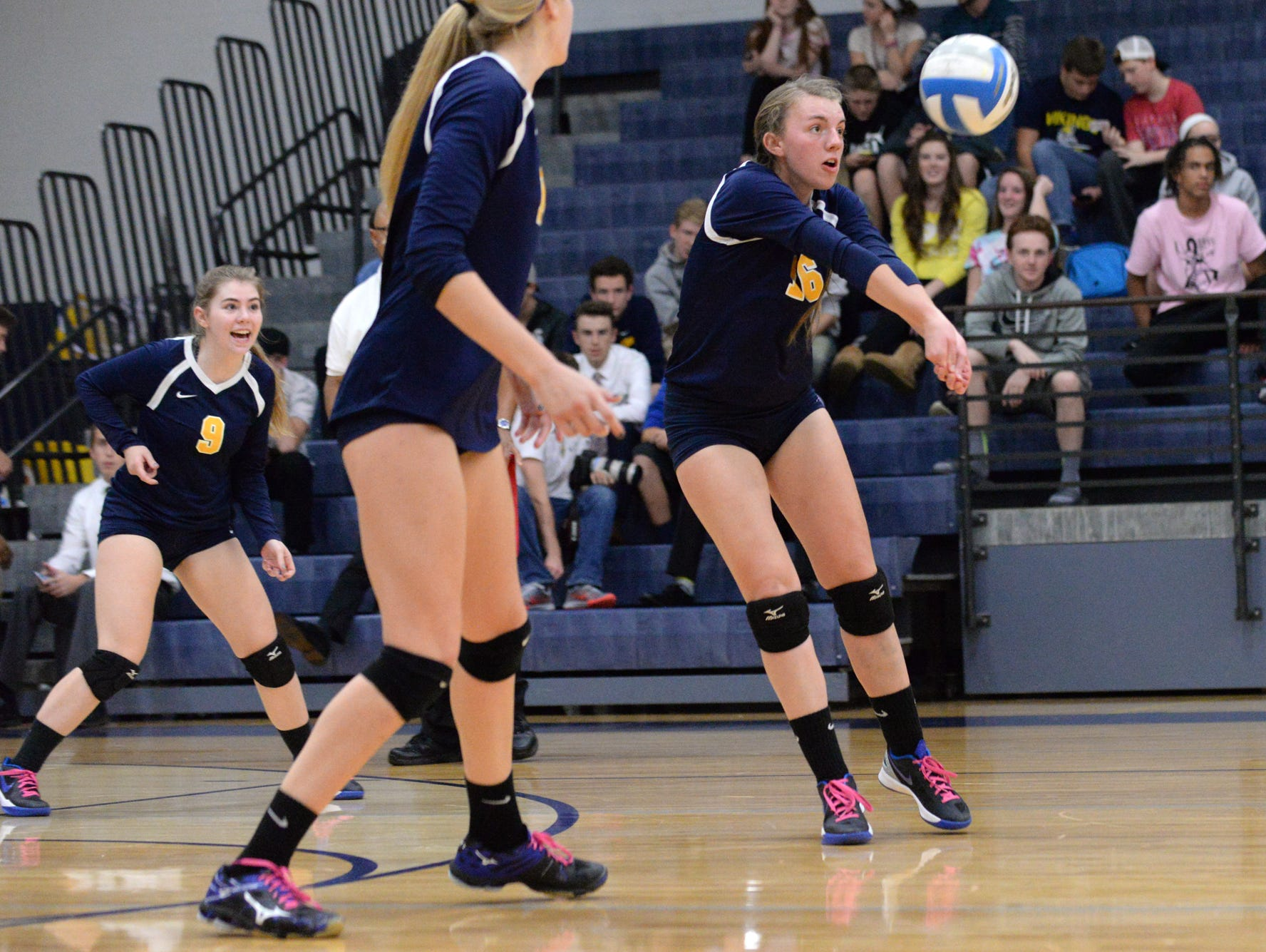 Haslett's Abby Boss bumps the ball during the Class B Volleyball District Tournament against Williamston at Haslett High School.