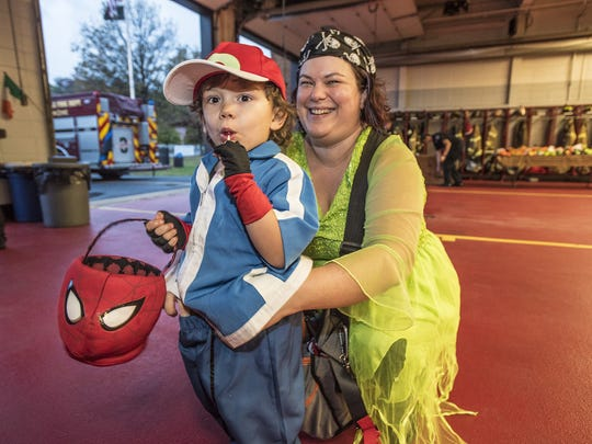 (L-R) Tristan Gould, 4, of Denville and mom Katie at the Denville Halloween party held at the Main street firehouse substituting for the annual Halloween parade, October 30, 2016.