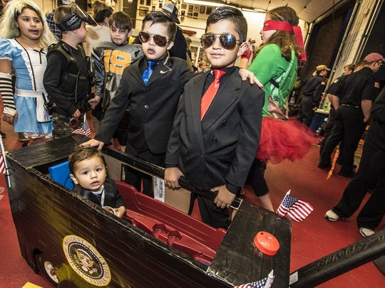 Future President C.J. Ciullo, 15 months old of Denville, and his Secret Service team brothers Gio, 9, and Jaden, 7,  at the Denville Halloween party held at the Main street firehouse substituting for the annual Halloween parade, October 30, 2016.