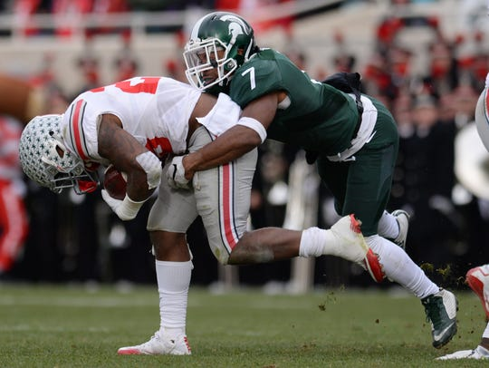 Senior defensive back Demetrious Cox tackles Ohio State
