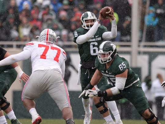 MSU junior quarterback Damion Terry catches the snap during MSU's 17-16 loss to Ohio State last Saturday. Terry has completed 15 of 34 passes this season.