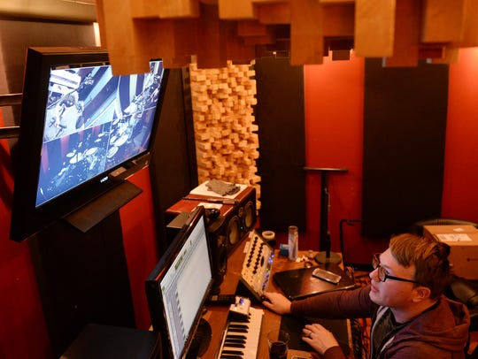 Owner Ryan Wert works during a recording session for