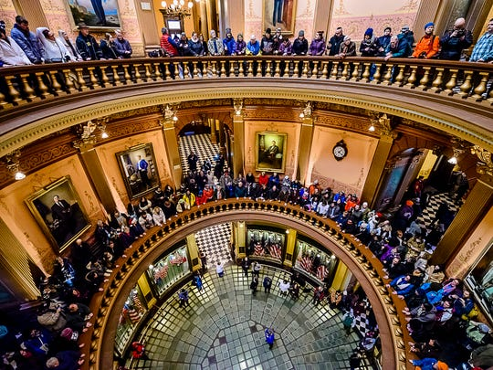 Protesters line the levels of the rotunda during an