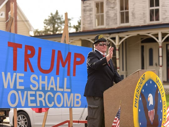 """Donald Trump"" rallies for votes on a float in Middletown's 2015 Hummer's Parade."