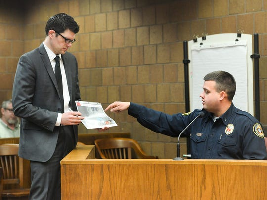 Assistant Ingham County Prosecutor Jonathan Roth asks