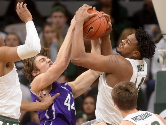 Freshman forward Nick Ward battles Northwestern forward