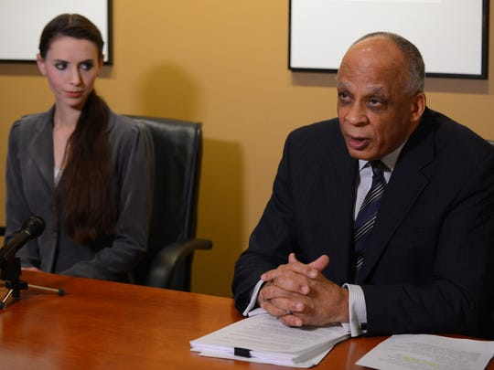 Attorney Stephen Drew speaks to the media as former gymnast Rachael Denhollander sits beside him on Tuesday, Jan. 10, 2017 at the law offices of Drew Cooper and Anding in Grand Rapids. Denhollander is one of the plaintiffs in a federal lawsuit against Larry Nassar, Michigan State University, USA Gymnastics and Twistars alleging Nassar sexually assaulted her.