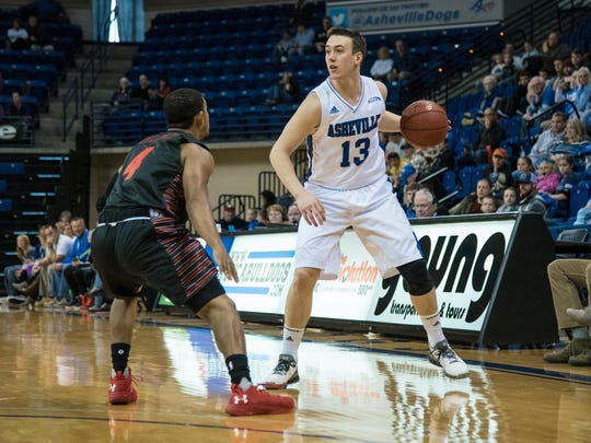 UNC Asheville senior guard David Robertson (13), shown in action last month, led the Bulldogs with 23 points against Campbell.