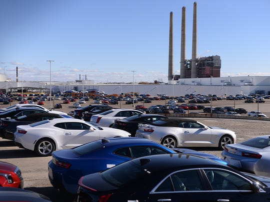 Cadillacs and Camaros sit in the parking lot at GM's Lansing Grand River Assembly plant in Lansing. The Cadillac ATS and CTS will likely be replaced by the new CT5 after 2019.