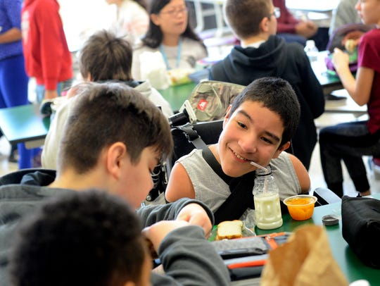 Zeke Holmes talks to his friends during lunch at Hope