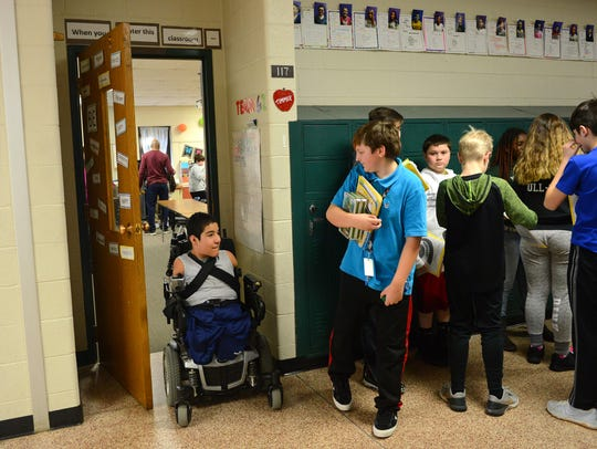 Zeke Holmes moves to another classroom on at Hope Middle