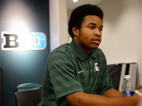 Early enrollee Josiah Scott speaks to the media during