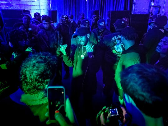 "Big Sean raps along to tracks from his new album during a small, intimate album listening party Sunday January 29, 2017 at the Museum of Contemporary Art Detroit in midtown. His new album titled ""I Decided"" comes out Friday. (Photo by Bryan Mitchell/Special to Detroit News)"