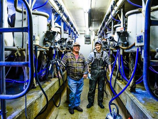 Fogle Farms owner Rick Fogle, left, and Dan Abbott,